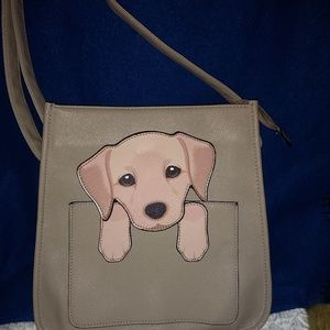 Adorable shoulder bag with cute puppy on it.